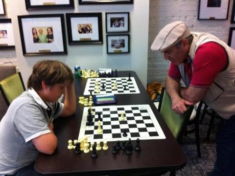Sam trains with chess legend Garry Kasparov as part of the Kasparov Chess Foundation's Young Stars program.