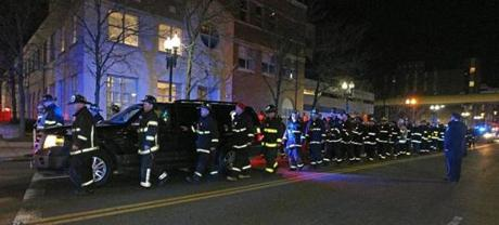 03/26/14: Boston, MA: A nine alarm fire broke out this afternoon at 298 Beacon Street. Two Boston firefighters were killed battling the blaze. Tonight, the body of one of the victims was escorted by fellow firefighters as they drove