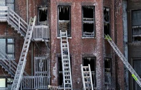 Ladders rested against windows covered in ice at the scene of Wednesday's nine-alarm fire on Beacon Street in the Back Bay.