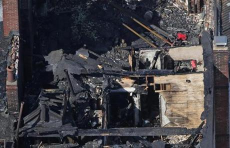 The top floor could be seen through the collapsed roof.