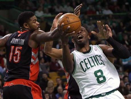 Boston, MA - 03/26/14 - (1st half) Boston Celtics forward Jeff Green (8) draws contact as he is defended by Toronto Raptors forward Amir Johnson (15) in the first half. Celtics NBA basketball. The Celtics play the Toronto Raptors at TD Garden. - (Barry Chin/Globe Staff), Section: Sports, Reporter: Baxter Holmes, Topic: 27Celtics-Raptors, LOID: 7.3.1550010039.