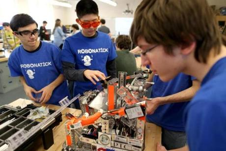 Natick Ma 3/27/2014 Natick High School Robotics students Joe Zonghi (cq) left and Bryn Lin (cq) in class. They are getting ready for a competition. Boston Globe Staff/Photographer Jonathan Wiggs Topic: Reporter: