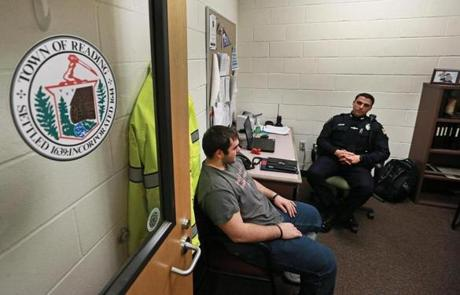 Reading police officer Corey Santasky talks with senior Jim King in his office at Reading High School.