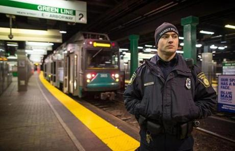 Transit Police officer Matt Drouin patrolled the Green Line platform at Park Street station at 3 a.m.