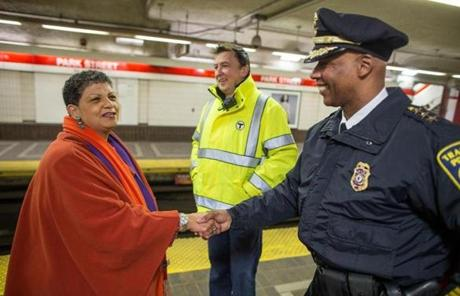 MBTA General Manager Beverly Scott greeted Transit Police Deputy Chief Kenneth Green, as Sean McCarthy, chief operating officer for the T, stood by.