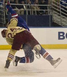 Bill Arnold was called for a penalty as he took down Joe Gambardella during first-period action.