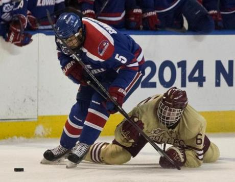 Steve Santani (right) and Joe Gambardella battled for control of the puck.