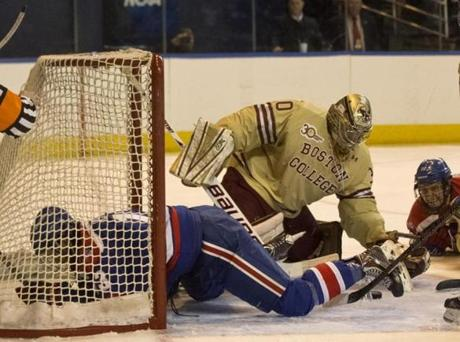 Boston College's Thatcher Demko stopped the puck, but not UMass-Lowell's Adam Chapie, from sliding into the net. The Eagles took on the River Hawks in the NCAA Northeast Regional final on Sunday.