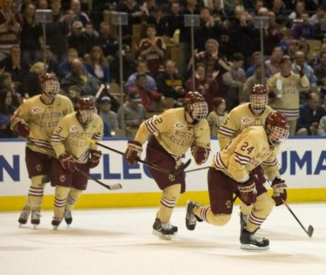 Bill Arnold led his teammates to the bench after scoring a goal in the second period.