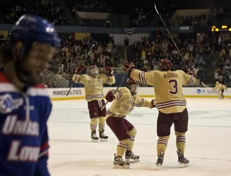 Ian McCoshen celebrated his game-winning goal with teammates Teddy Doherty (center) and Bill Arnold.
