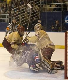 Ian McCoshen took down Evan Campbell in front of the Eagles' Thatcher Demko.
