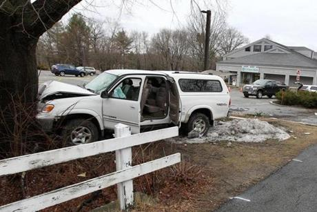 A Toyota Tundra crashed into a tree near a Rite Aid store on Lowell Street in Concord Monday during a chase through several communities.