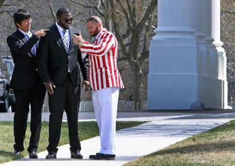 While Koji Uehara (left) and David Ortiz (center) seemed suitably attired for the occasion, Jonny Gomes made a much bolder -- and spectacularly patriotic -- fashion statement at the White House.
