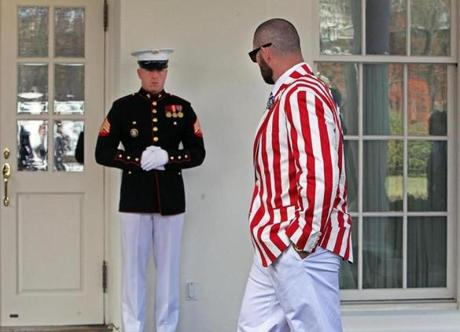 04/01/14: Washington, D.C: Sharp dressed men............The Red Sox Jonny Gomes, dressed in his USA best, checks out a US Marine in his best also, as he walks by the West Wing of the White House, on his way to speak to the media about his impressions of the event which had just concluded. President Barack Obama hosted the 2013 World Series Champion Boston Red Sox to the White House today. A ceremony was held on the South Lawn. (Jim Davis/Globe Staff) section: sports topic: Red Sox(1)
