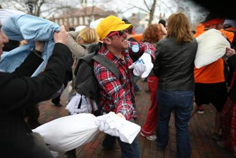 The event was part of International Pillow Fight Day. Pictured: Jeremie Blais at the Cambridge Common.