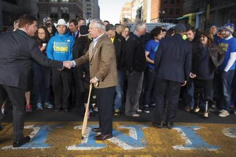 Boston Mayor Martin Walsh shook the hand of former longtime Boston mayor Thomas Menino at the finish line of the Boston Marathon.