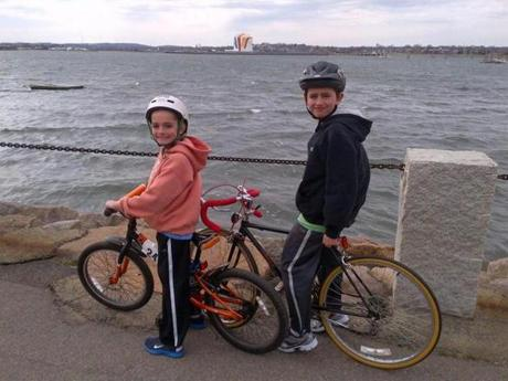 Henry and Martin Richard riding bikes on Dorchester Bay in the fall of 2012.