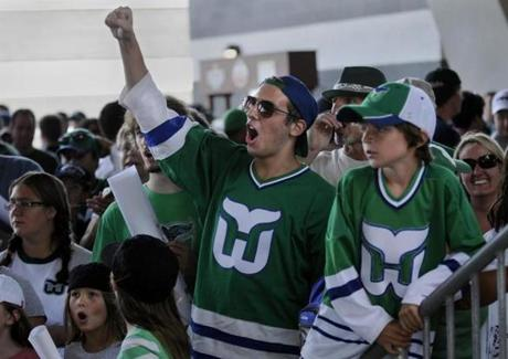 EAST HARTFORD-8/14/10- There was a sea of Whlers jerseys and Whale logos everywhere you looked during the Whalers Fan Fest held at Rentschler Field on Saturday. An estimated 5,000 die-hard Hartford Whalers fans converged on the stadium to wait in line for hours to have the former Whalers players sign autographs. In photo,Skyler Calibey of West Hartford cheers as former Whalers players are introduced to the crowd.