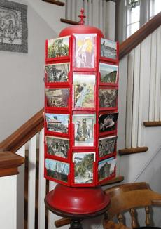 Coover's home is filled with postcards and other items from his travels.