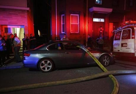 A car parked in front of a fire hydrant had a hose run through the windows.