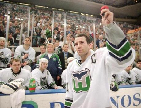 FROM MERLIN ARCHIVE DO NOT RESEND TO LIBRARY Hartford Whalers captain Kevin Dineen waves to the fans Sunday, April 13, 1997, after he briefly addressed them at the end of the Whalers final game in Hartford, Conn. The Whalers defeated the Tampa Bay Lightning 2-1 to end their season and their stay in Hartford. (AP Photo/Richard Mei) Library Tag 08102008 Sports