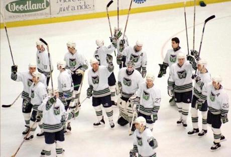 Members of the National Hockey League Hartford Whalers salute the fans at the end of their final game in Hartford, Conn., with the Tampa Bay Lightning Sunday, April 13, 1997. The team is daparting the city after 22 years. The owners have not revealed where the team will move to. (AP Photo/Steve Miller)