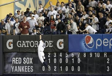Yankees right fielder Ichiro Suzuki catches a drive to the wall by David Ortiz in the eighth inning.