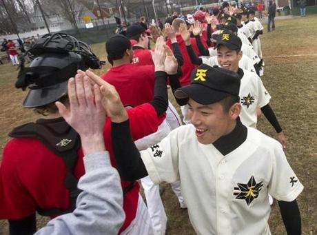 Riku Yokote led Tennoji players as they high-fived their Hingham counterparts after the scrimmage.