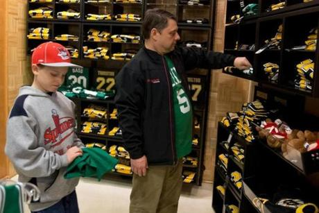 Bruins gear was predominant as Bob Gagne of Lincoln, R.I., and his son Tim shopped in the Proshop at TD Garden during a Celtics game last Friday.