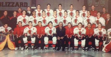 Bergeron, foreground with captain's 'C' on his jersey, at the center of his high school team photo.