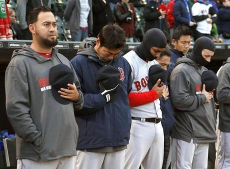 Red Sox players stood for a moment of silence before the game.