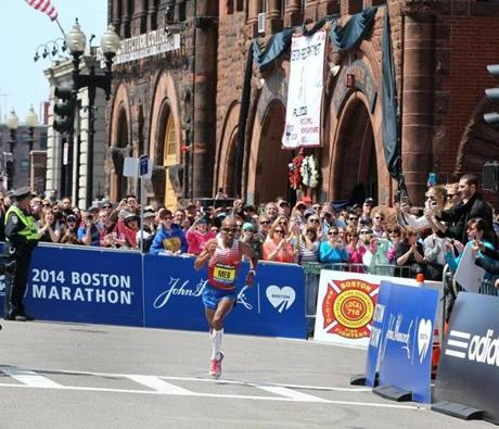 Hopkinton to Boston, MA--4/21/2014--Men's winner Mebrahtom Keflezighi (cq) #19, USA, turns onto Boylston Street from Hereford Street. The 118th Boston Marathon is run, on Monday, April 21, 2014. Photos by Pat Greenhouse/Globe Staff Topic: 22marathon Reporter: XXX