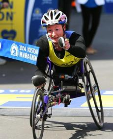Boston04/21/14- At the Boston Marathon at the finish line ground level on Boylston Street women's wheelchair winner Tatiana Mcfadden crosses the finish line. Globe staff photo by John Tlumacki (metro)