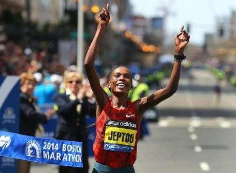 Women's winner Rita Jeptoo crossed the finish line.