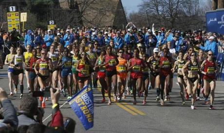 Hopkinton, MA - 4-21-14 - Elite women start the Boston Marathon in downtown Hopkinton. (Bill Greene / Globe staff)