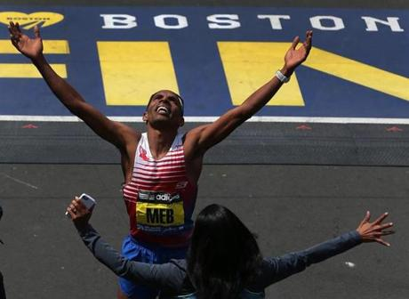 Men's winner Meb Keflezighi celebrated at the finish line.