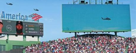 Military helicopters made a dramatic pass above  Fenway Park while en route to the Boston Marathon's finish line.