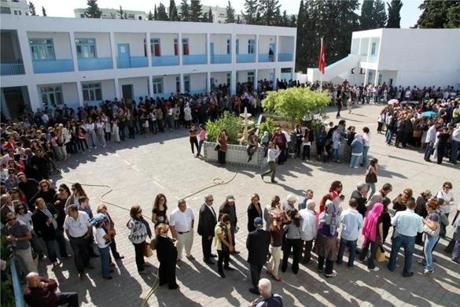 Tunisian voters lined up at a polling station in Menzeh, near Tunis.