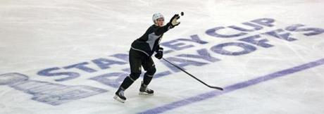 The Bruins' Dougie Hamilton handles a flying puck at Wednesday's workout; the youngster manages off-ice issues, too.