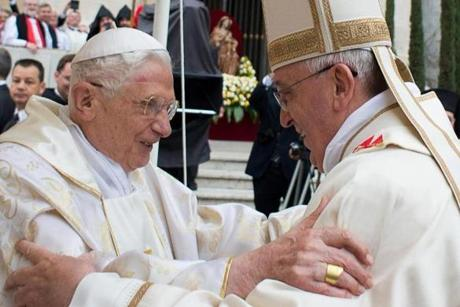 Pope Francis (right) greeted his predecessor, Benedict XVI, who has remained largely out of the public eye since his resignation last year.