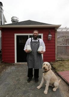 Marblehead, MA - 04/30/14 - For Food: Cover story on salt. Andrew Bushell, cq, owner of Marblehead Salt Co. and his dog Theo. - (Barry Chin/Globe Staff), Section: Lifestyle, Reporter: Gillian O'Callaghan, Topic: 04salt, LOID: 7.3.2417982454.