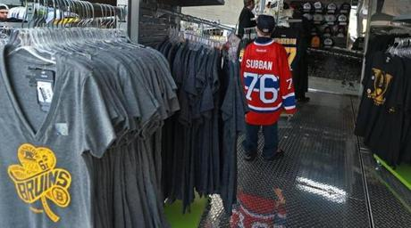 At the Bruins Playoff Shop outside TD Garden, a young fan wearing a Canadiens P. K. Subban sweater shopped among the Bruins merchandise.