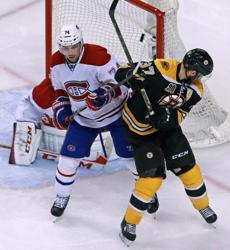 Alexei Emelin and Patrice Bergeron battled in front of the net, but the puck was already sailing into the net as Reily Smith (not pictured) scored in the third period. The score was 2-1 Montreal.