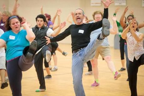 Paul Fallon, an architect, rehearses with his fellow dancers at the Reggie Lewis Track and Athletic Center in Roxbury.