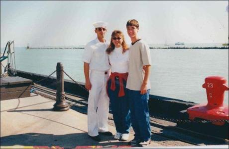 Jesse Reynolds with his mother, Debby Dageforde, and his half-brother J.D. in Chicago after Jesse finished Naval Boot Camp in 2001.