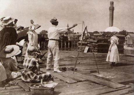 Charles Hawthorne led a painting class on a Provincetown wharf around 1910. Hawthorne started teaching open-air painting in 1899, and the art colony was born. He continued teaching until his death in 1930.