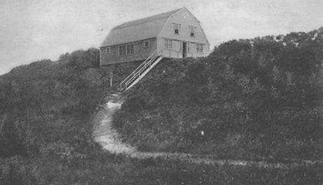 The barn was built on a sand dune a century ago by painter Charles Hawthorne. Pictured: The barn in about 1920.