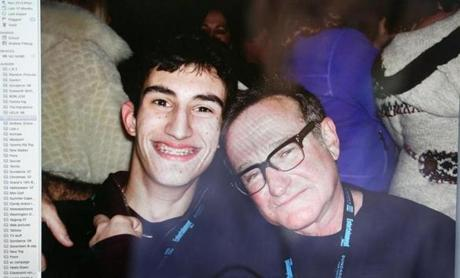 Andrew Pilkington has a collection of photographs of himself with celebrities at the Sundance Film Festival. Here, he poses with Robin Williams.