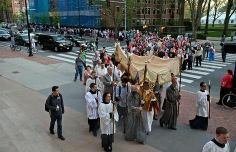 Hundreds of Catholics marched from MIT Chapel to St. Paul Church in Cambridge.