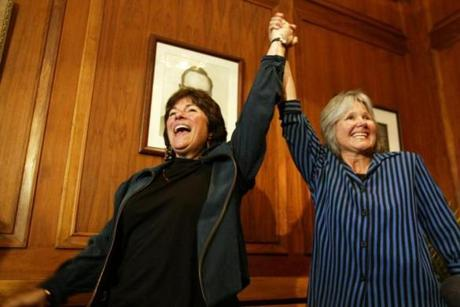 GAY MARRIAGE REMOTE TRANSMISSION -- REMOTE TRANSMISSION--- 5/17/2004 -- Cambridge, MA -- Cambridge City Hall -- Marcia Kadish (left) and Tanya McCloskey spontaneously display their exuberance at having just been prounced wife and wife by City Clerk D. Margaret Drury. They were the first couple to be married in Cambridge on Monday morning. Library Tag 11112007 Magazine